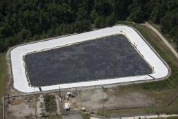 Evaporation and algae control cover on a water retention pond